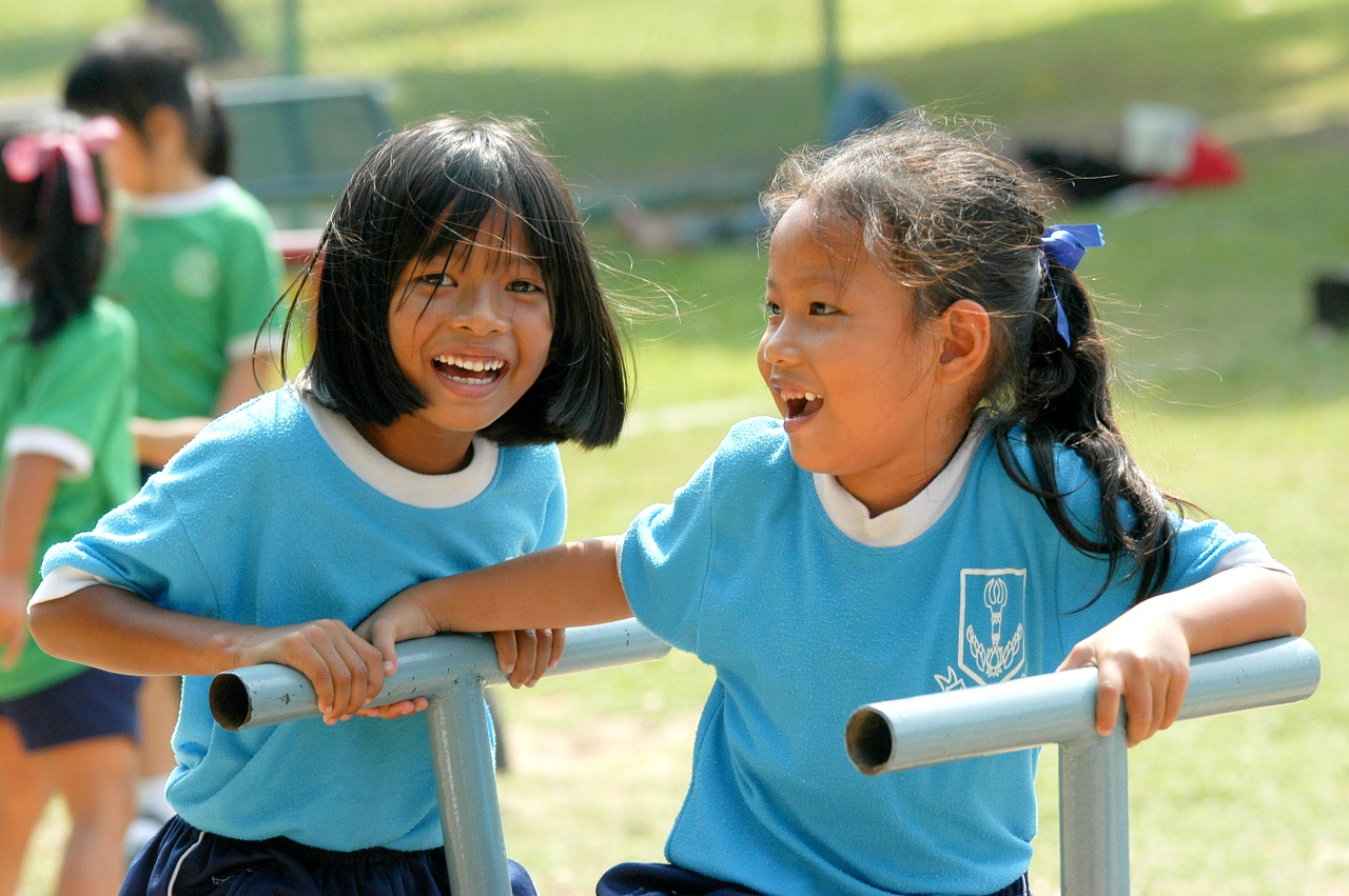 School kids are enjoying active play time, Thailand.