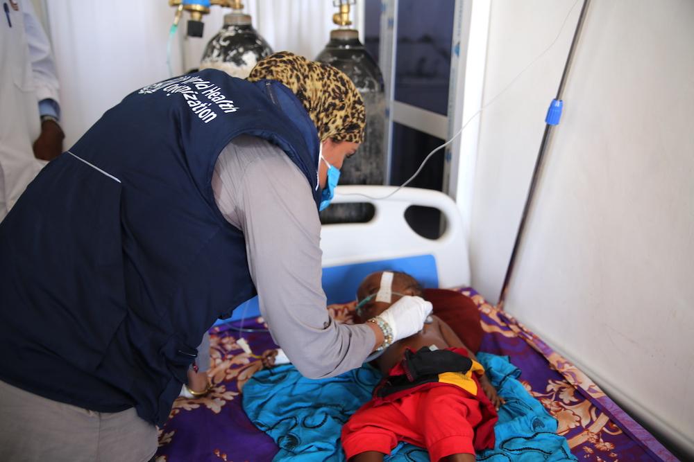 An infant battling pneumonia in De-Martini hospital in Somalia
